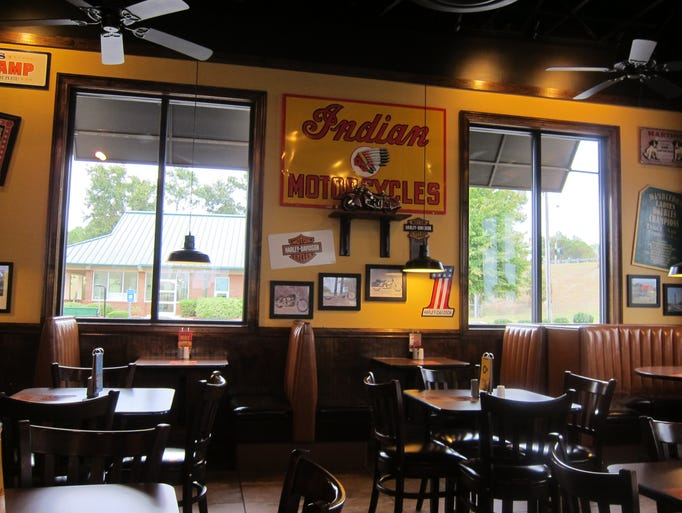 "A step up from most fast food restaurants, each Zaxby's is decorated differently, but the common theme is ""vintage,"" in the form of signs, toys or sports gear.  Leather seating and wooden booths also give Zaxby's a more sit-down feel even though you order at the counter like other fast food eateries."