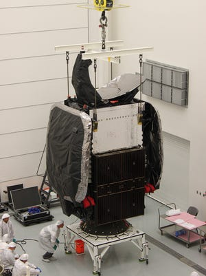 The SES-8 satellite sits atop a payload adapter within the SpaceX processing facility at Cape Canaveral Air Force Station, Fla., as part of a pre-launch fit-check. The Luxembourg-based company already has 54 communications satellites in orbit.