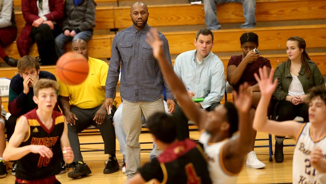 Bremerton boys basketball coach Miah Davis and the Knights endured a difficult season on the court this winter. The Knights won their first game against Klahowya on Jan. 26, snapping a 22-game losing streak dating back to last season.