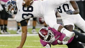 Carlos Javier Sanchez - Sun-News New Mexico State Aggie Winston Rose tackles Georgia Southern Eagle Matt Breida during the first half of play at Aggie Memorial Stadium in Las Cruces New Mexico on Saturday, October 4, 2014.