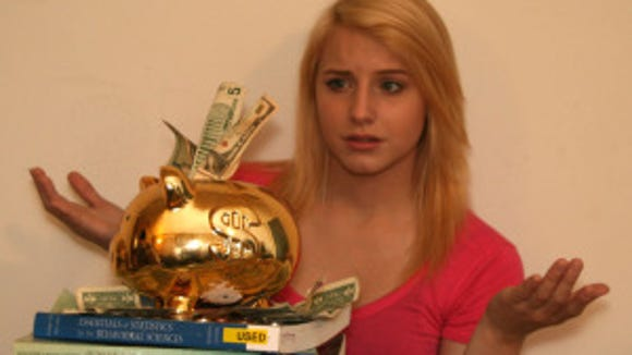 photo illustration: Hannah Dimolfetto,19, peers over a piggy bank.