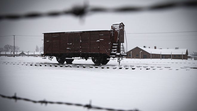 Train cars packed with Jews from all over Europe  arrived at Auschwitz-Birkenau in Poland, where 1.1 million would be killed.