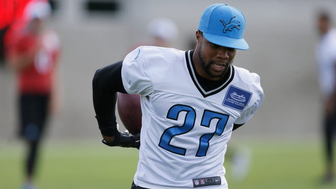 Detroit Lions safety Glover Quin runs a drill at training camp Aug. 21, 2015, in Allen Park.