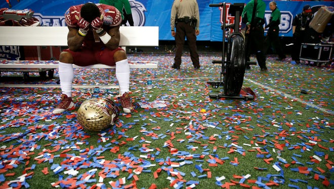 Florida State's Tyler Hunter hides his face in his jersey after the Seminoles lost 38-24 to the University of Houston for the Chick-fil-A Peach Bowl at the Georgia Dome on Thursday, Dec. 31, 2015.