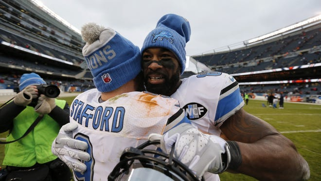 Matthew Stafford hugs Calvin Johnson after Johnson's final game, in Chicago, in January.