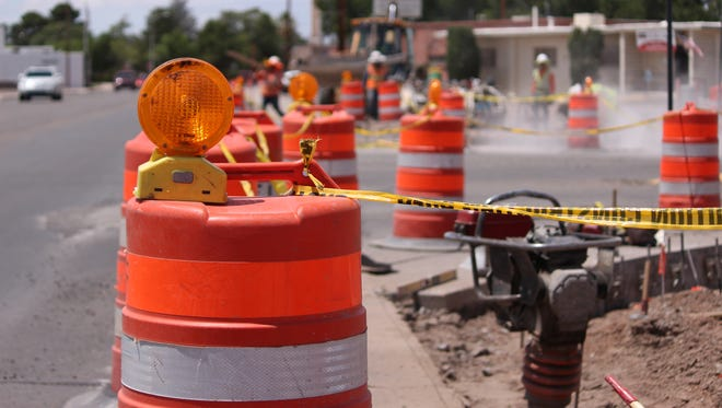 Motorists are asked to drive with cauton while construction crews work on curbing and sidewalks along Cody Road.