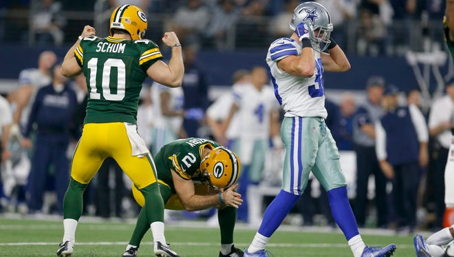 Packers kicker Mason Crosby is overcome with emotion after kicking the winning field goal as punter Jacob Schum celebrates and Cowboys safety Jeff Heath walks away.