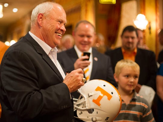 Former Tennessee football coach Phillip Fulmer signs autographs at the Tennessee Theatre on Aug. 9, 2013, during a 15th anniversary celebration of 1998 Fiesta Bowl National Championship and fundraiser to benefit to St. Jude Children's Research Hospital.