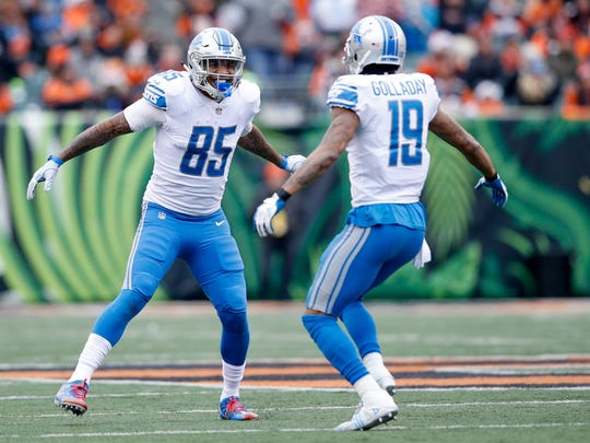 Eric Ebron (85) of the Detroit Lions celebrates with Kenny Golladay (19) against the Cincinnati Bengals during the first half at Paul Brown Stadium on December 24, 2017 in Cincinnati, Ohio.