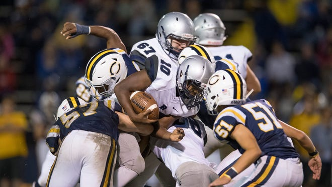 Reitz's Da'Ziaun Sargent (10) runs against Castle's defense at John Lidy Field Friday night. Sargent ran for 328 yards and three touchdowns in the Panthers' 44-33 win.