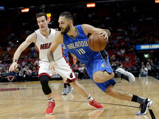 Orlando Magic's Evan Fournier (10) drives to the basket as Miami Heat's Goran Dragic defends during the first half of an NBA basketball game, Monday, Feb. 13, 2017, in Miami. (AP Photo/Lynne Sladky)