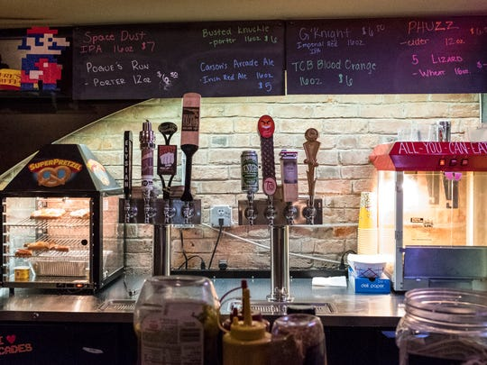 High Score Saloon has eight craft beers on tap, plus bottled domestic beer, wine and soft drinks. A small selection of food – including small pizzas, hot dogs, popcorn and pretzels – is also served at the bar.