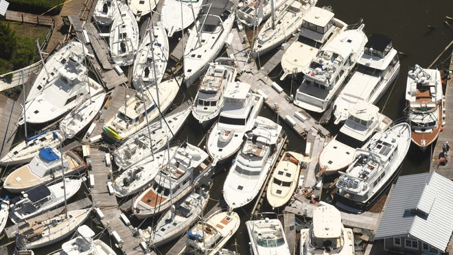 Boats are stacked on top of each other in the Southport Marina on Tuesday, Aug. 4, 2020 in Southport, N.C., after Hurricane Isaias came ashore overnight in Brunswick County as a category 1 hurricane.