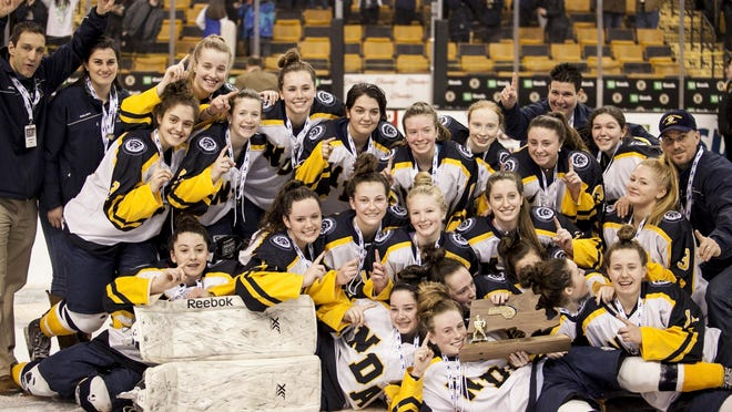 The Notre Dame Academy girls hockey team poses with their trophy after their win over Canton in the MIAA Championship at TD Garden on Sunday, March 19, 2017.