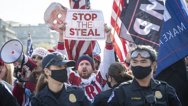 Nov 14, 2020; Washington, DC, USA; Supporters and protesters of President Donald Trump clash outside of the United States Supreme Court while demonstrators march during the Million MAGA March. Mandatory Credit: Jack Gruber-USA TODAY