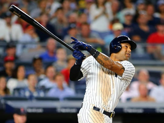 Aaron Hicks was placed on the disabled list Sunday with a left oblique strain.