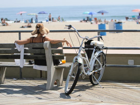 A woman relaxes on the Asbury Park boardwalk.