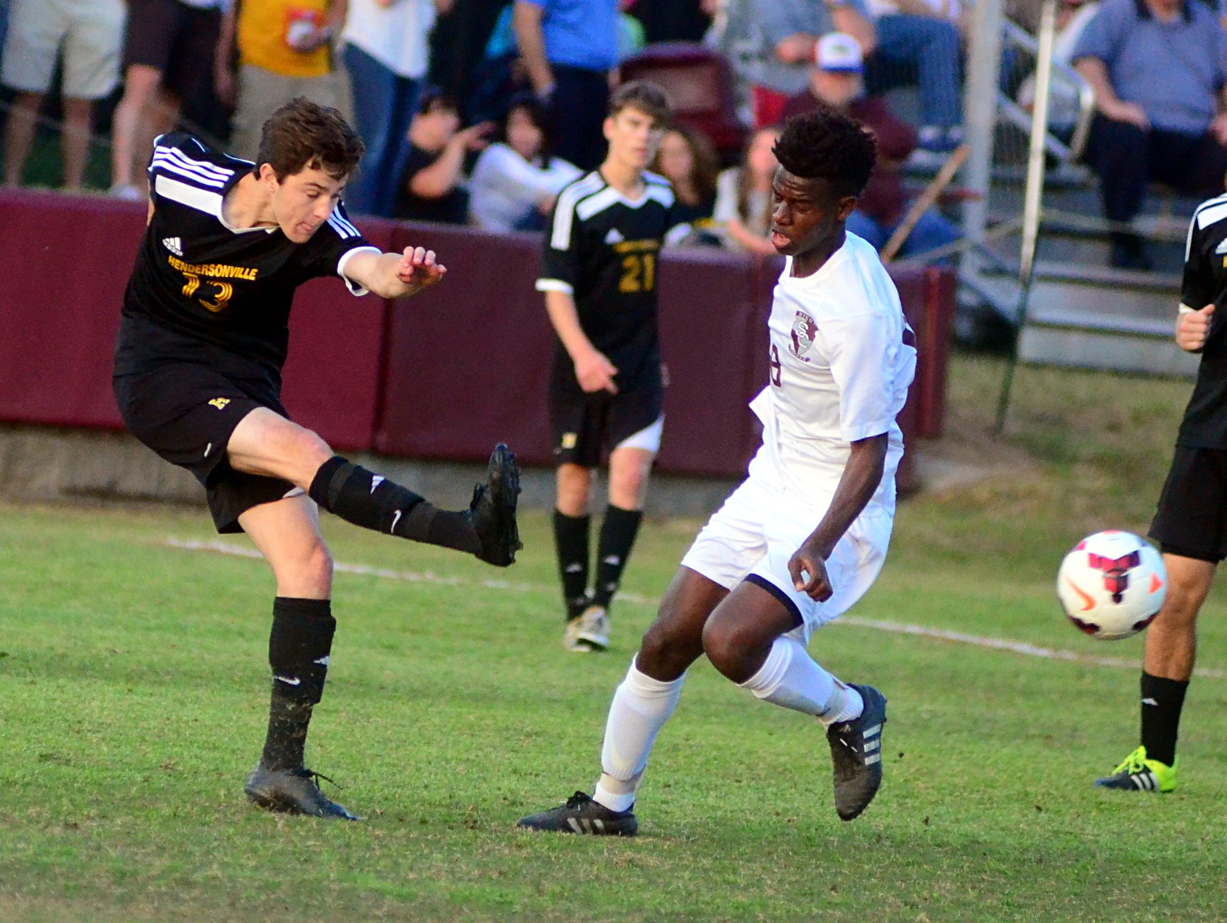 Hendersonville High senior Cole Egan steps into a shot in front of Station Camp sophomore Atakelti Gebregzabher during first-half action.