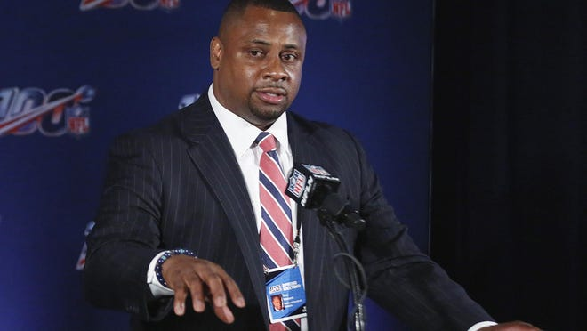 In this May 22, 2019, file photo, Troy Vincent, NFL executive vice president, speaks to the media during the owners meetings in Key Biscayne, Fla.