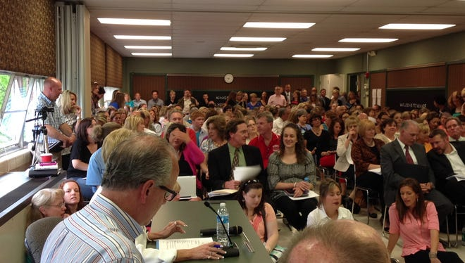 The largest crowd in a decade packed Tuesday's meeting of the Kings school board.