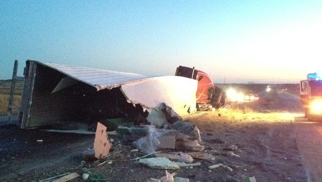 The scene from a semi trailer crash near the Cumming exit on Interstate 35 Monday.