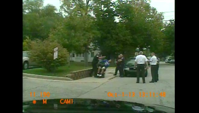 Screenshot from the video of Lt. Tom Davidson shoving a wheelchair user into the street.