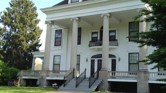 The historic Basil Doerhoefer Mansion in the 4400 block of West Broadway has been repaired after a car crashed into the front staircase and porch.