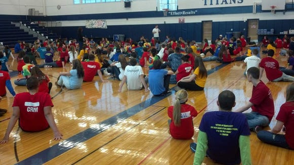 In the Webster Thomas gymnasium, more than 200 Link Leaders listen to a motivational talk by Patrick Maurer.