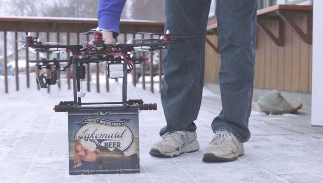 A drone begins to hoist a 12-pack of Lakemaid Frosty Winter Lager before delivering the beer to ice anglers on Lake Waconia in Minnesota.