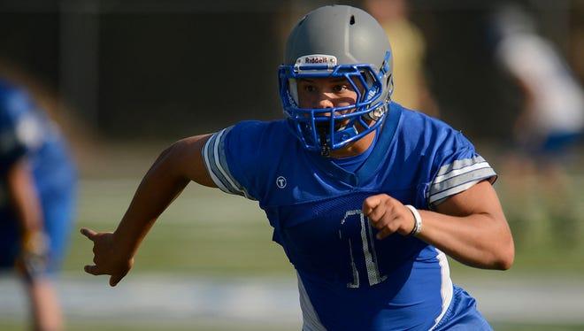 Green Bay Southwest's Kieran Thomas runs drills during football practice at Southwest High School in Green Bay on Wednesday, Aug. 6, 2014. Evan Siegle/Press-Gazette Media