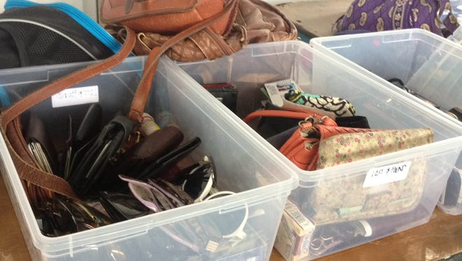 Bins of wallets and sunglasses  at Firefly's Lost and Found tent.