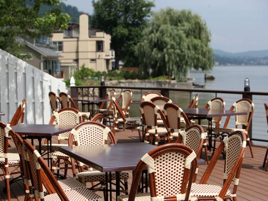 Outdoor dining with Hudson River views are seen at