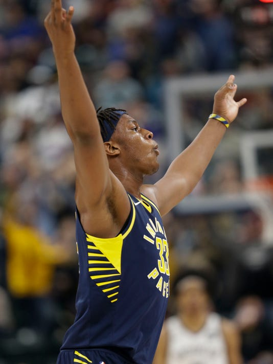 Indiana Pacers center Myles Turner (33) celebrates a three-point shot against the Brooklyn Nets during the second half of an NBA basketball game in Indianapolis, Saturday, Dec. 23, 2017. The Pacers won 123-119 in overtime. (AP Photo/AJ Mast)
