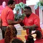 Actors Lamman Rucker and Rodney Perry talk with students at Excellence Academy. They are in town for a school fundraiser.