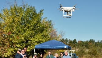 Scientists demonstrate a drone used by the Meadowlands Environmental Research Institute (MERI) to survey areas that are inaccessible by conventional means.