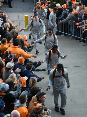Tennessee players during the Vol Walk before the Franklin American Mortgage Music City Bowl at Nissan Stadium in Nashville, Tenn., Friday, Dec. 30, 2016.