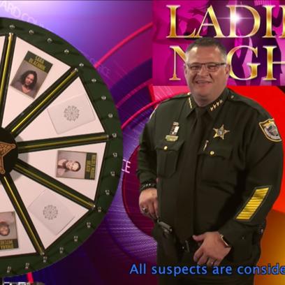 "A video still from ""Wheel of Fugitive: Ladies Night."""