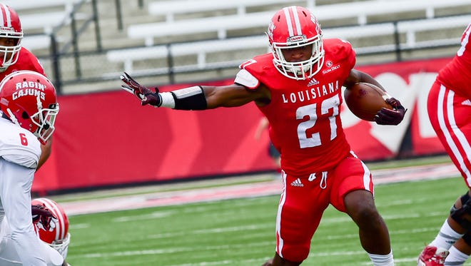 UL running back Jordan Wright finds a hole for a big run during the Cajuns' spring game Saturday at Cajun Field.