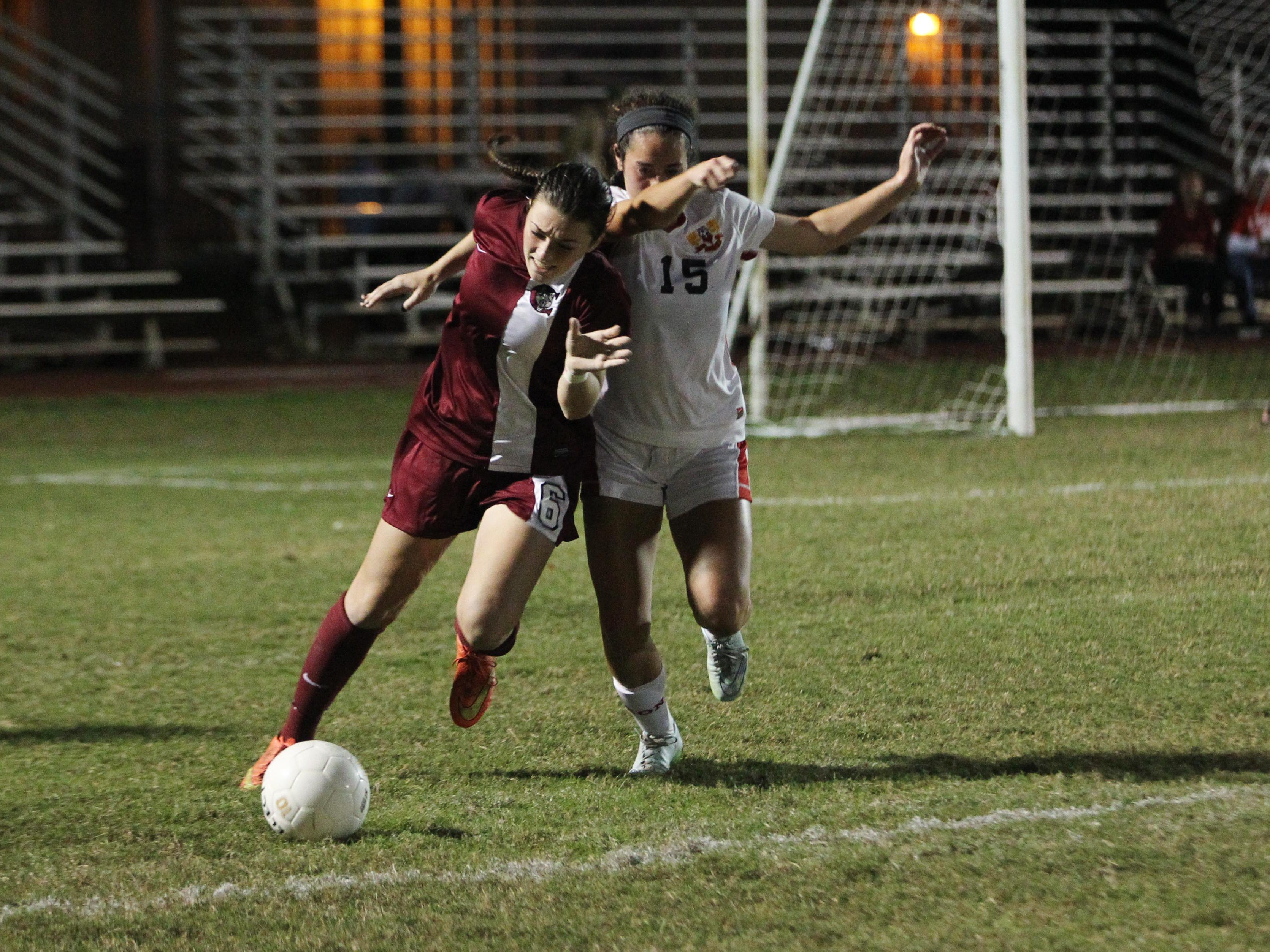 Chiles junior Olivia Snow battles Leon freshman Liney Brantley for the ball in a game between Leon and Chiles.