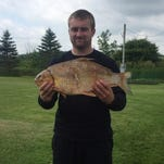 Garrett Reid of Nashville caught a state-record quillback carpsucker on June 20, weighing in at 8.25 pounds.