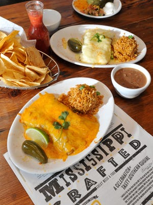 Beef and chicken enchiladas, garnished with chips, salsa and beans, are among the favorites at the Iron Horse Grill in downtown Jackson.