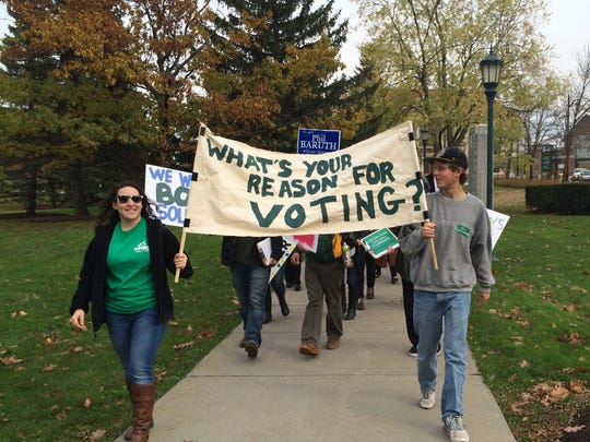 """A """"student stampeded to vote"""" drew about two dozen students from a march to Burlington City Hall Tuesday to sign up to vote in the upcoming election."""