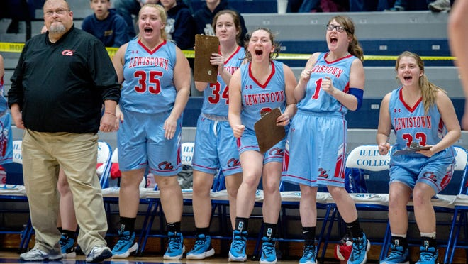 The Lewistown bench erupts as the Indians take a commanding lead over Father McGivney late in the fourth quarter of their Class 1A basketball supersectional Monday, Feb. 24, 2020 at Illinois College in Jacksonville. The Indians advanced to the state tournament with a 64-46 victory.