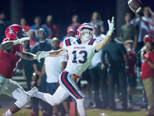 Wide Receiver Landon Meche reaches for a pass as Catholic
