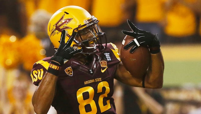 Kevin Ozier celebrates an ASU touchdown against Sacramento State at Sun Devil Stadium on Sep. 5, 2013 in Tempe.
