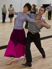 Luciano Catelli, owner of Shore DanceSport, gives a lesson to Doreen Bender of Brielle in his Brick dance studio.