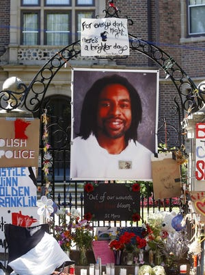 """A memorial including a photo of Philando Castile adorns the gate to the governor's residence on July 25 where protesters continue to demonstrate in St. Paul against the July 6 shooting death of Castile by St. Anthony police Officer Jeronimo Yanez during a traffic stop in Falcon Heights. The city of St. Anthony released a statement Wednesday saying that Yanez is back on administrative leave """"after reviewing concerns and other feedback from the community."""" Yanez returned to work for the first time last week following the death."""
