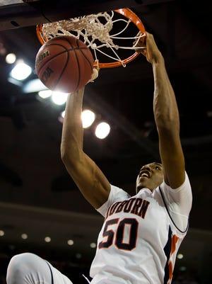 Auburn's Austin Wiley (50) dunks during the NCAA Basketball game between Auburn and Alabama on Saturday, Jan. 21, 2017, at Auburn Arena in Auburn, Ala.