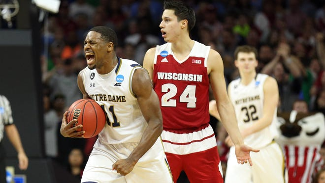 Notre Dame Fighting Irish guard Demetrius Jackson (11) reacts against the Wisconsin Badgers during the second half in a semifinal game in the East regional of the NCAA Tournament at Wells Fargo Center.