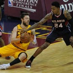 May 24, 2015; Cleveland, OH, USA; Cleveland Cavaliers guard Matthew Dellavedova (8) and Atlanta Hawks guard Kent Bazemore (24) during the first quarter in game three of the Eastern Conference Finals of the NBA Playoffs at Quicken Loans Arena
